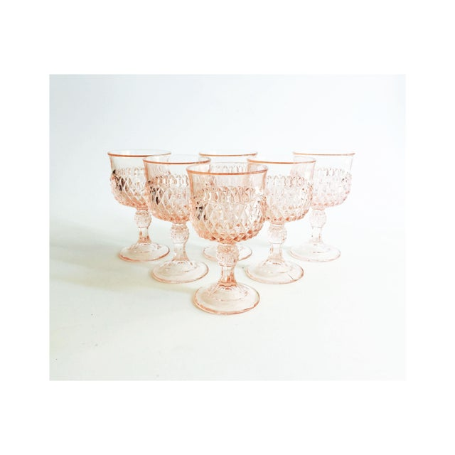 A set of 6 vintage wine glasses in a blush pink hue. Each glass has a gorgeous crystal cut design to the outside of the...
