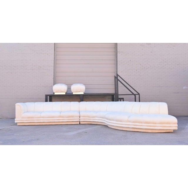Three-piece sofa by Vladimir Kagan with two ottomans. Depth measurement below is the depth from front to back of any...