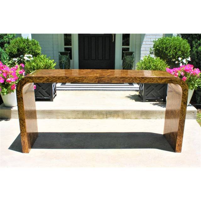Classic Karl Springer style waterfall console table in a feathered tortoise glaze finish. If you don't like the finish,...