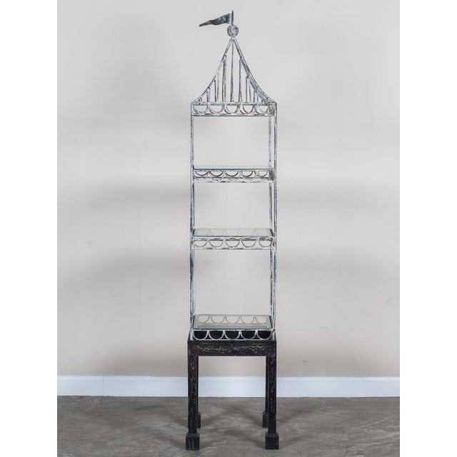 The charm of this vintage French display cabinet circa 1950 is a combination of its open shelves, painted finish and...