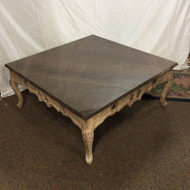 Large, low, and lovely! This unique gray marble topped table is a substantial piece that would complete a beautiful living...