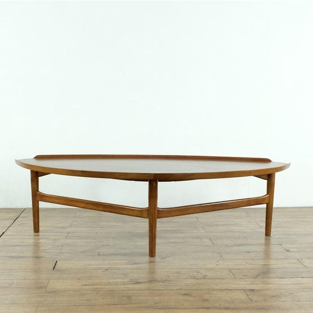 Excellent condition, with one small flaw, as noted in photos. Finn Juhl's cocktail table was designed for Baker Furniture...
