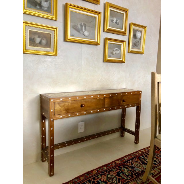 This one of kind hand crafted writing desk has natural diamond shape mother of pearl inlay with lines of silver metallic...