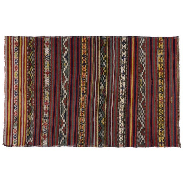 Vintage Turkish Kilim rug with tribal style, flat-weave rug. This rug features multicolor geometric tribal motifs and...