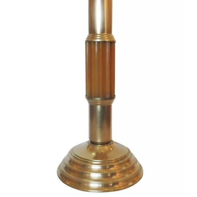 Art Deco celluloid and brass table lamp with stepped brass base and stem. The center column is made of a solid ribbed...
