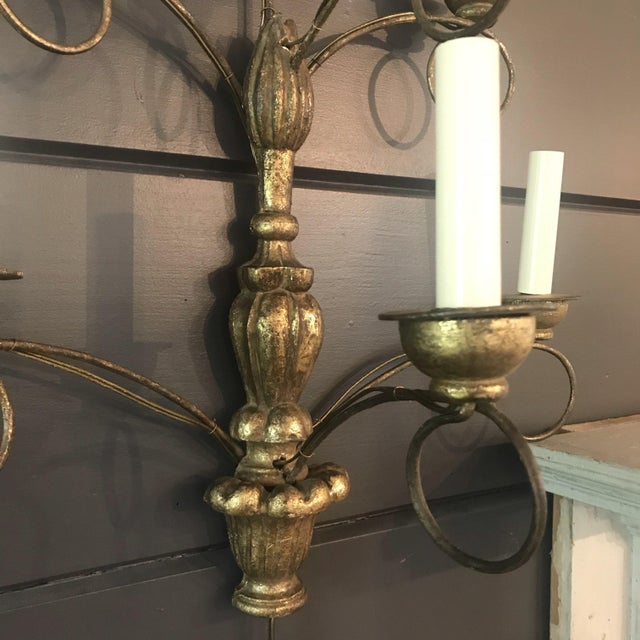 A large elegant pair of French water gilt gold carved sconces with beautiful graduated urn design, with metal scrolled...