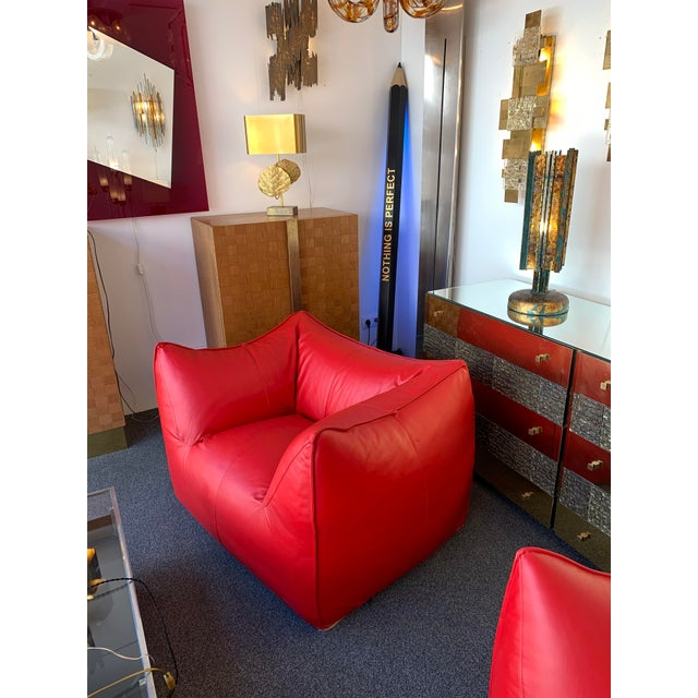 Pair of large armchairs model Le Bambole in red leather by Mario Bellini for the manufacture B&B Italia. Bellini won the...