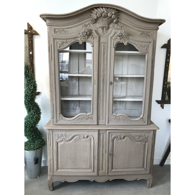Beautifully carved oak buffet with elegant paint wash. Four locking doors, two interior drawers and shelving for storage....