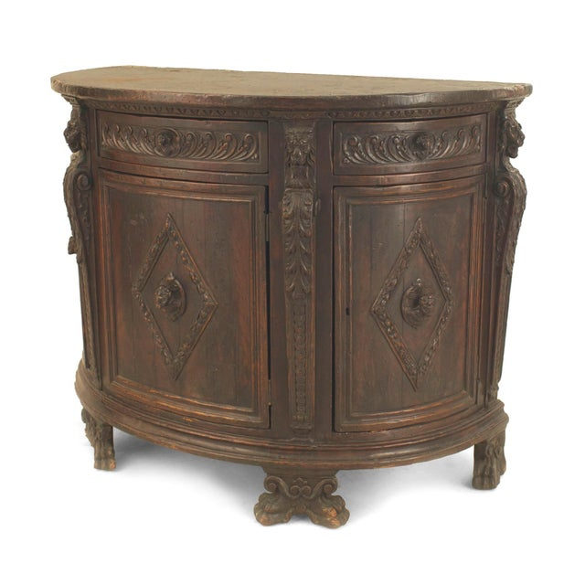 Italian Renaissance 17th century walnut demilune shaped commode with carved trim and a diamond design on the front and...