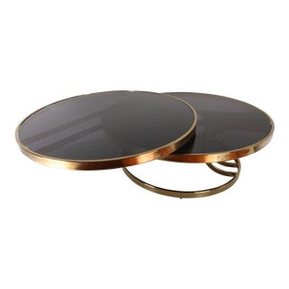 1970s Mid-Century Modern Design Institute America Round 2-Tier Swivel Brass and Glass Cocktail Table For Sale