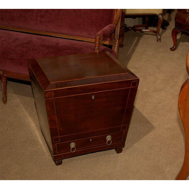 A nice Federal mahogany wine chest/cellarette Condition: Shrinkage, and wear with a well restored age crack and repairs to...