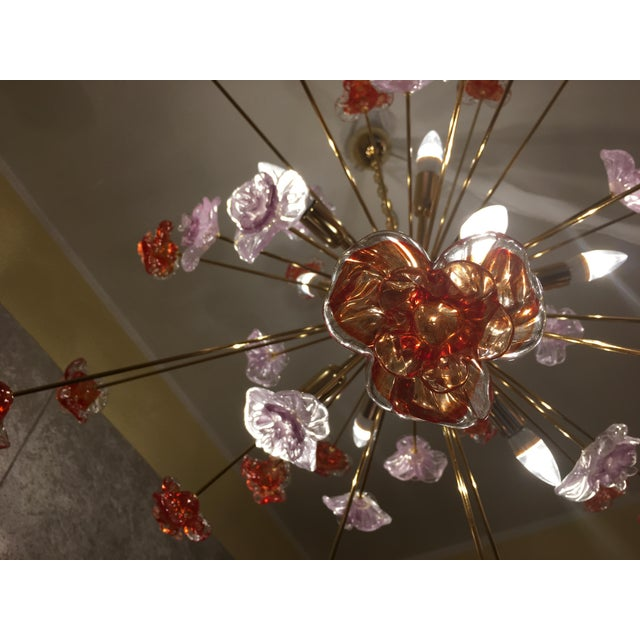 Contemporary Murano Glass Triedo Sputnik Chandelier with red and violet flowers and a gold colored metal frame. The...