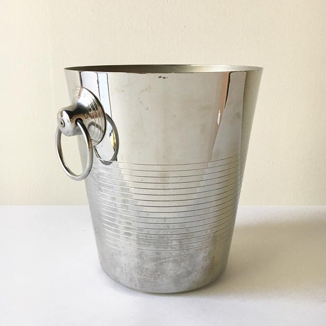 A French Stainless Steel Ice Bucket with Loop Handles by Letang Remy stamped to underside with makers mark NB: These items...
