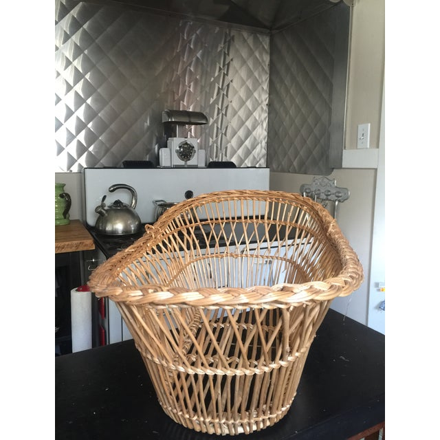 Your baby to go! Or trot around your laundry in this classic French basket from mid-century France. There are a couple of...