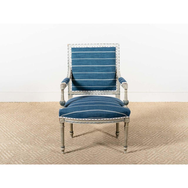 Antique painted wood fauteuil with newly upholstered striped blue linen. France circa 1885.