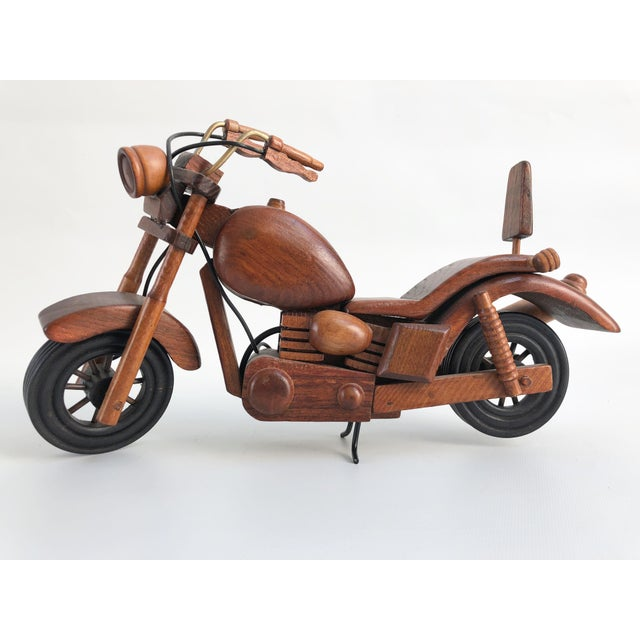 Vintage hand-crafted motorcycle model with individual cut pieces of wood and finished with a gloss varnish. No maker's mark.