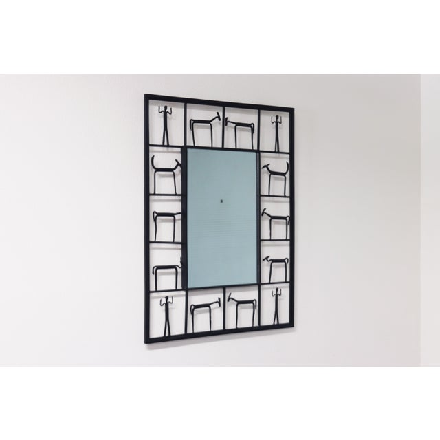 Here is a whimsical yet chic wall mirror designed by Frederick Weinberg. The fourteen panel wrought iron frame depicts...