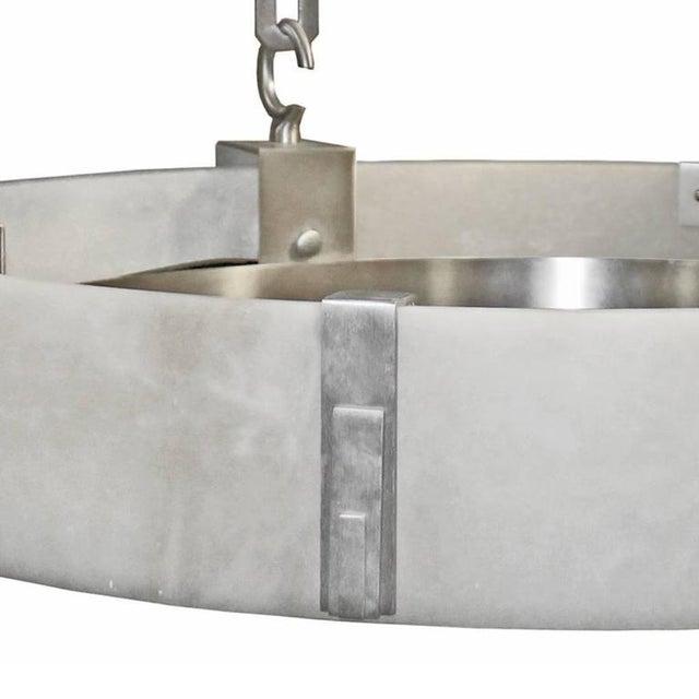 Modern flush mount chandelier with large handmade 36 diameter natural spanish alabaster stone ring shade. The chandelier...