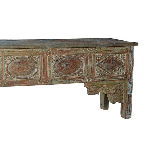 This antique carved wood painted console table features a light patina finish. It is made from hard woods of North India.