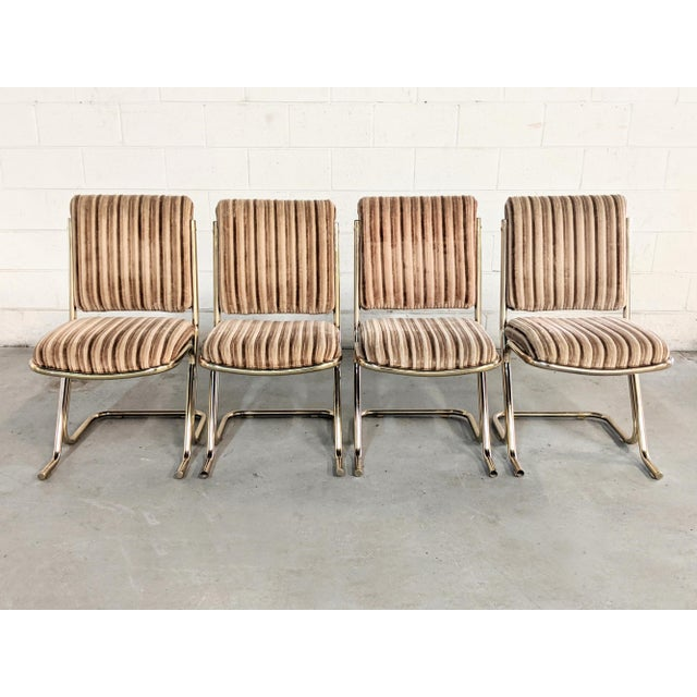 Available for purchase, a 1970's set of dining chairs from Chromcraft. The set includes 4 canitlever dining chairs with...
