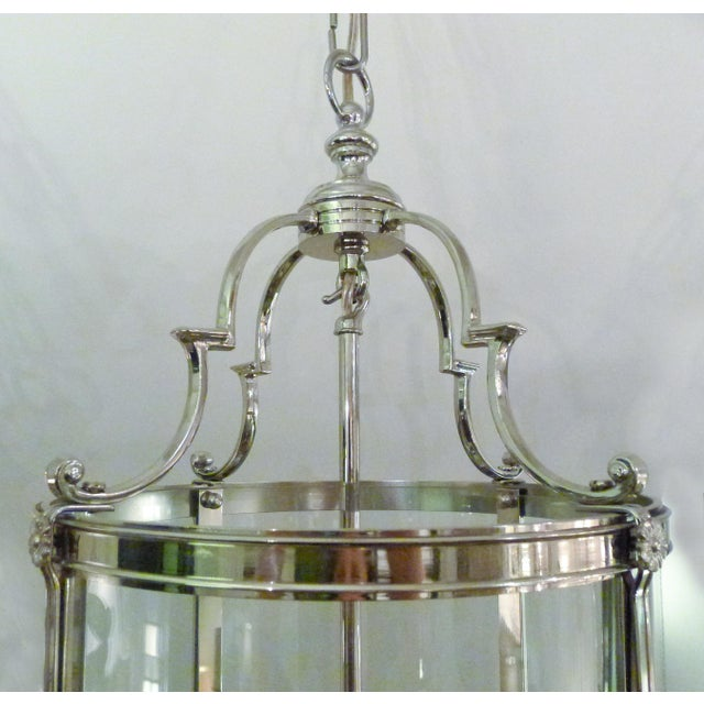 Hand-crafted of solid brass, plated in polished nickel, the round glass insert is custom bent to fit. The cluster holds...