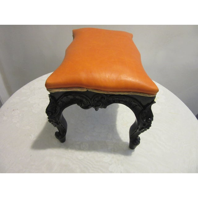 Beautifully restored lacquered mahogany highly carved footstool with leather upholstery. Lacquered black with a bright...
