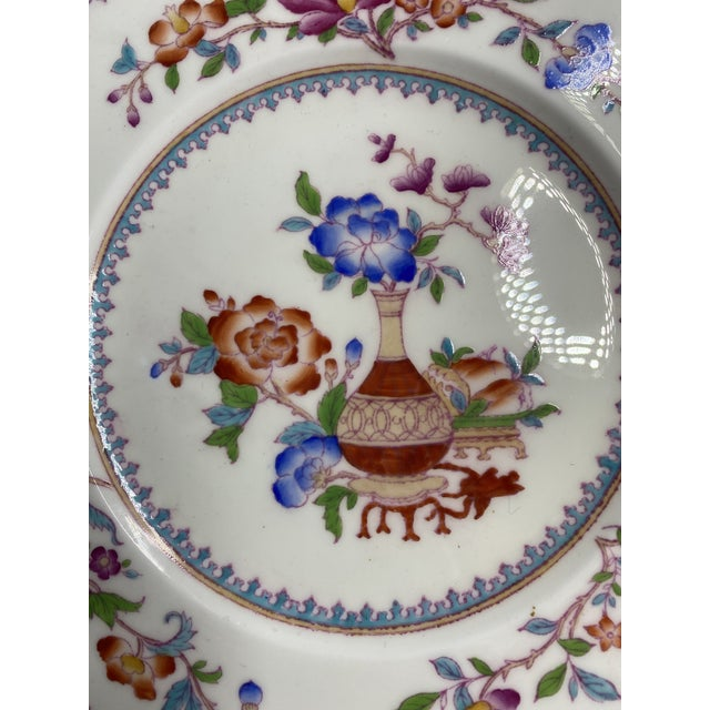 Hard to find matching set of 12 Cauldon hand painted chinoiserie patterned luncheon or small dinner plates. The coloring...