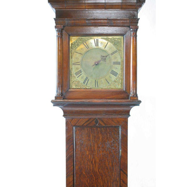A very charming early-18th century oak tall case clock by John Worsfold of Dorking. A single hand time and strike with a...