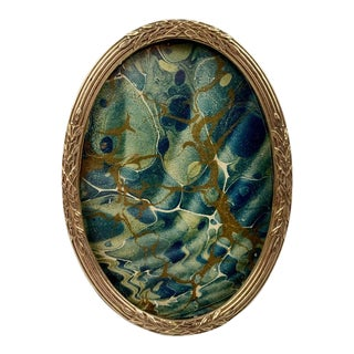 Small French Oval Louis XVI Gilt Frame With Crossed Ribbons Over Reeds For Sale