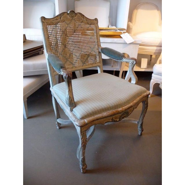 18th century painted cane-back armchair.