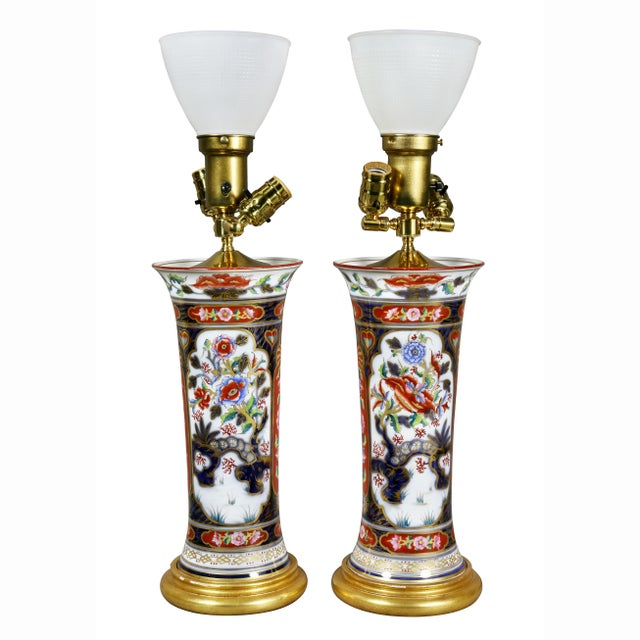 Circa 1880s victorian table lamps. Each wired, flared cylindrical form, giltwood base. Provenance; Michael D Dingman.