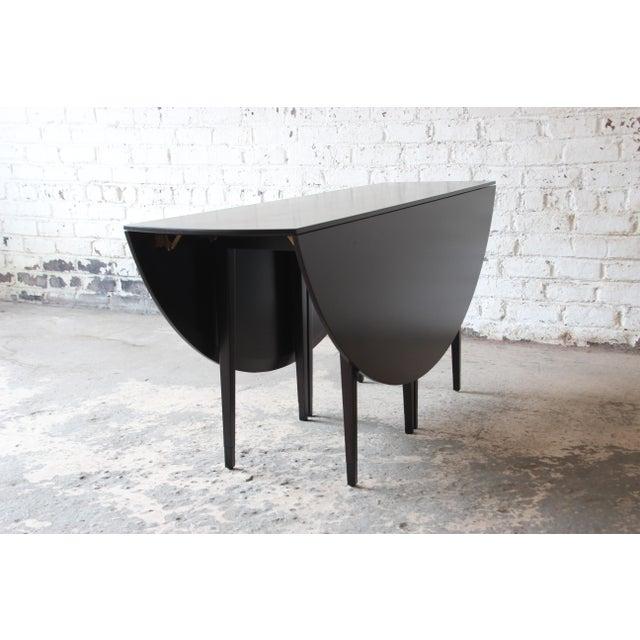 Edward Wormley for Dunbar Mid-Century Modern Walnut Oval Drop-Leaf Dining Table For Sale - Image 9 of 13