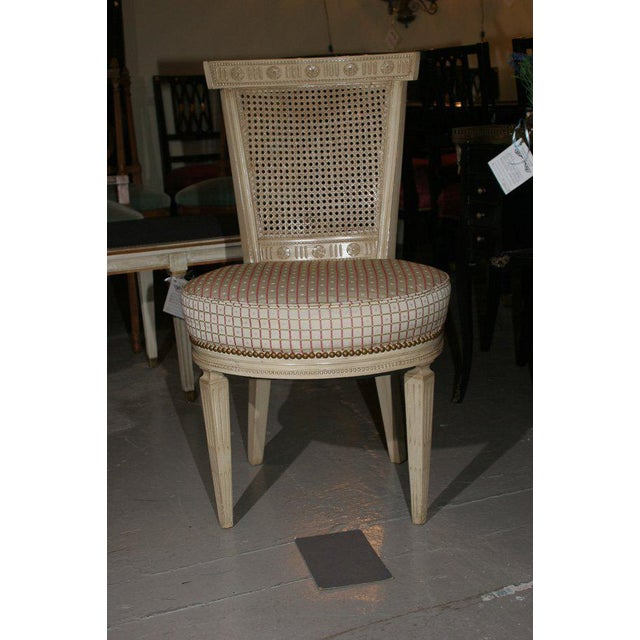 Fantastic set of four white washed cane Back Jansen chairs with Louis XV legs.