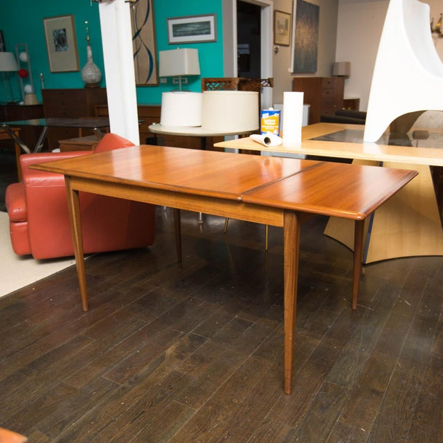 Beautiful apartment-sized Danish modern dining table in great shape. Trimmed in walnut inlays on top and solid walnut...