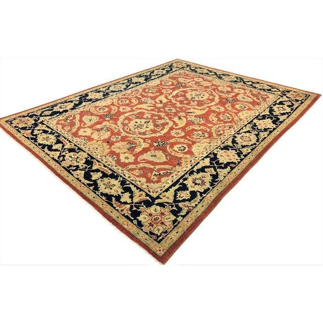 Simple and elegant this beautiful orange rust rug is especially designed to enhance any décor. This gorgeous hand knotted...