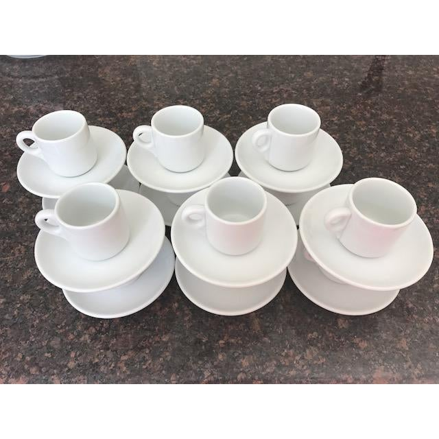 Purchased in Italy in the 70s; complete set of 12 white Richard Ginori Espresso/Demitasse Cups and Saucers. In very good...