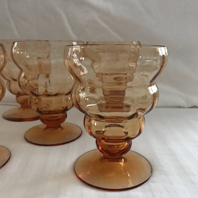 Very rare, set of 8 Amber ribbed, honeycomb, ice cream, parfait Glasses. I feel you can use this Glasses for anything....