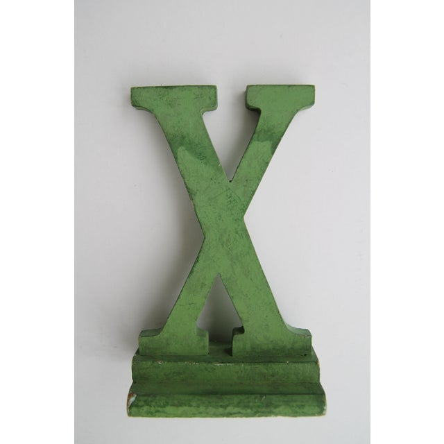 Vintage wood department store letter X in original green paint, found in Buffalo, NY.