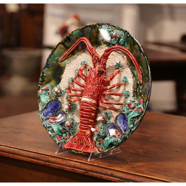 This colorful antique hand-painted majolica decorative wall platter was crafted in Brittany, France, circa 1930. Sculpted...