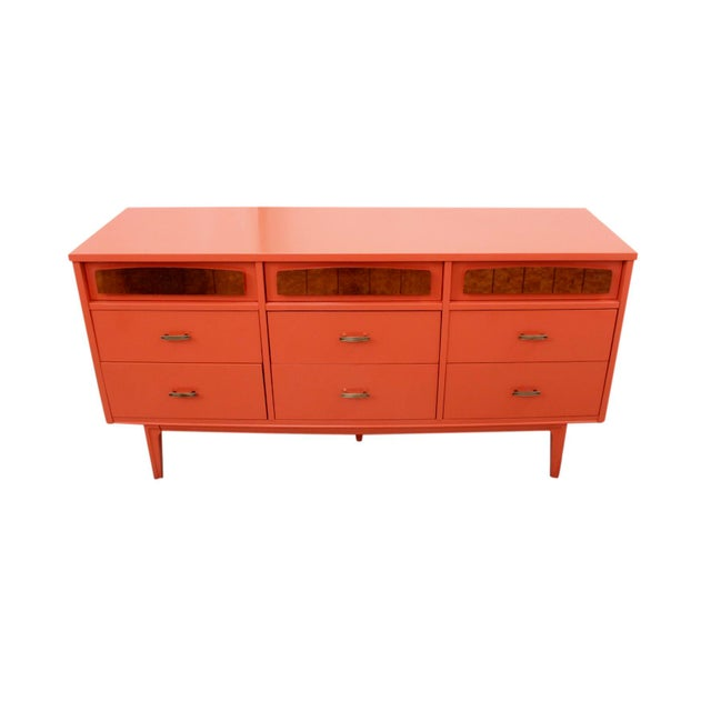 From the 1960's and made in the US, this nine drawer chest is styled after Danish designs. it came from a private...