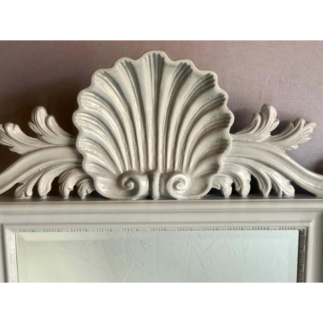Pair of shell carved wall, pier of console mirrors in gray lacquered finish. These mirrors have been recently refinished...