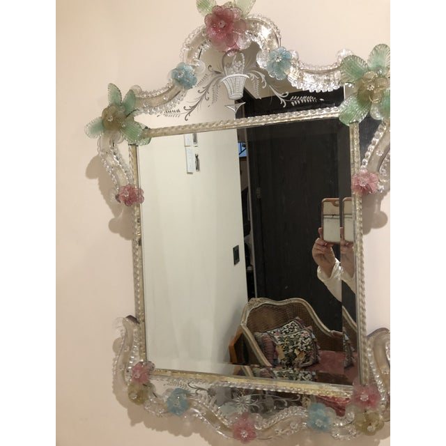This is a beautiful Murano mirror. Colors are so pretty. Combination of blue,green,pink and gold.