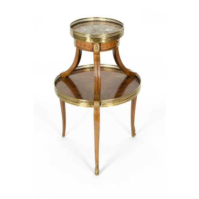 Early 19th century Louis XVI style mahogany marquetry and gilt bronze with marble top side table with front drawer. The...