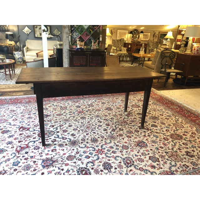 Oozing with French country antique character, a gorgeous heavy walnut farmtable having single drawer at each end and...