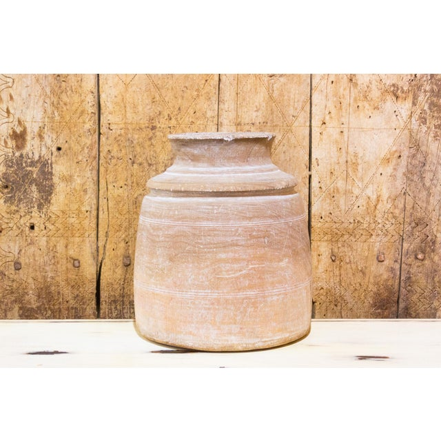 A stunning hand carved Nepalese wooden pot. These handmade containers were originally intended to store Ghee. It is...