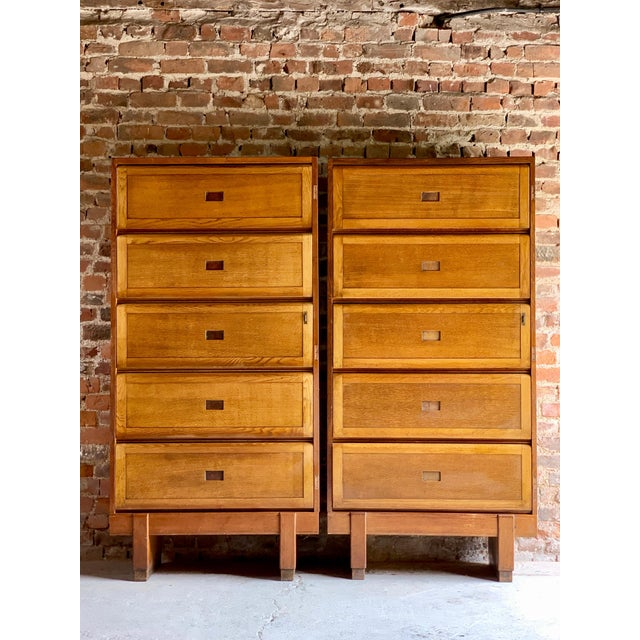 Mid-20th century large oak five shelf cabinet dated 1956, the rectangular top over five up and over sliding action doors,...