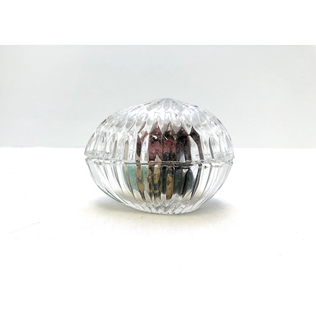 This crystal carved egg is a lovely home to seven unique gemstone eggs, each polished and with personality. The egg sizes...