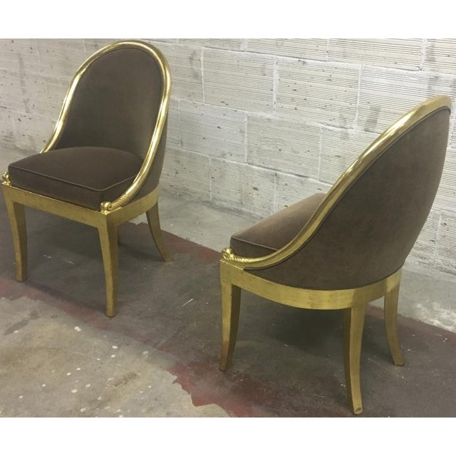 Maurice Dufrene refined Empire inspired gold leaf wood pair of side chairs.