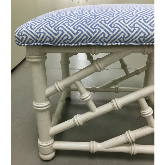 Faux bamboo bench newly painted in an antique white painted finish. Newly upholstered in Quadrille China Seas 'Java Java'...