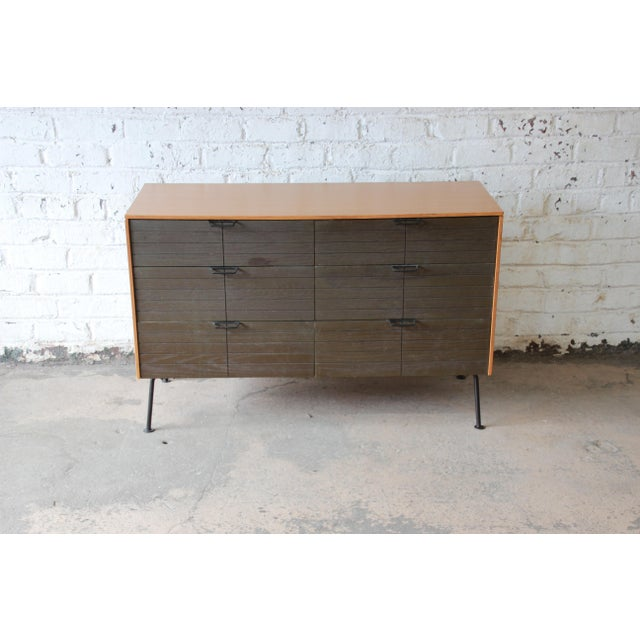 A rare and exceptional six-drawer Mid-Century Modern dresser designed by Raymond Loewy for Mengel Furniture Company. The...